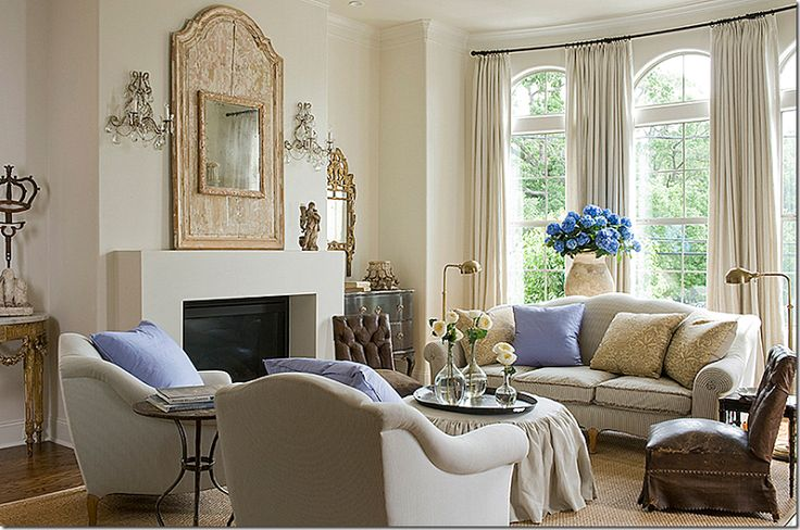 Arched windows Where to put the curtain rod – above or below the arch? Usually, I like this treatment shown here like Jane Moore did.