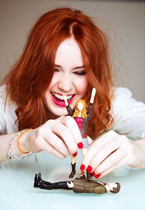 Karen Gillan Playing With Doctor Who Figurines