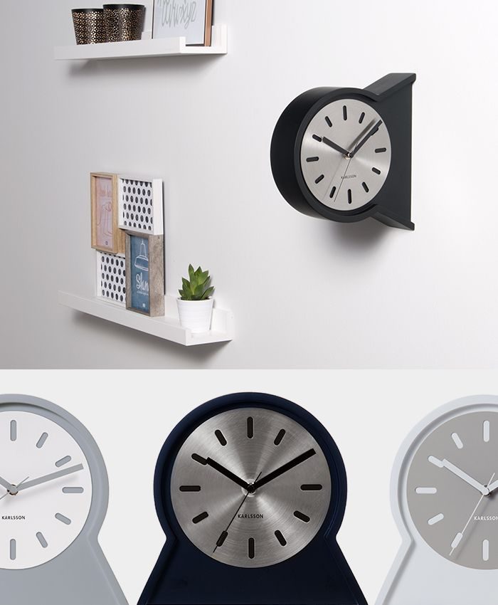 Double sided wall and table clock named Play. The steel dial can be moved as its attached by magnets to the wooden case.