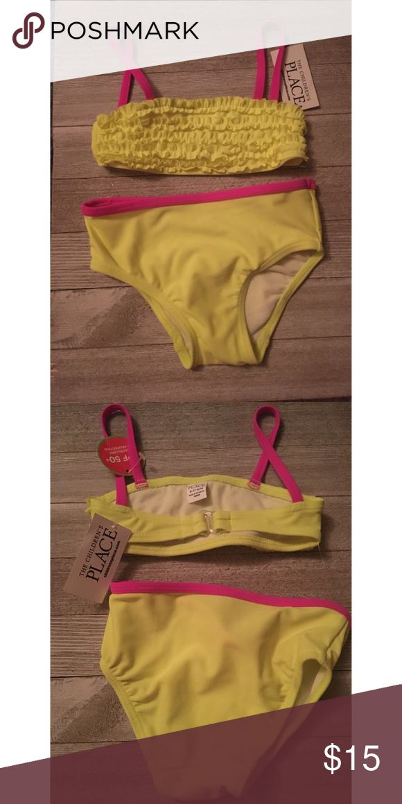 Neon Bikini👙 The suit is neon yellow with pink straps and band on bottom part. The top front also features ruffles.  This suit has never been worn and is new with tags The Children's Place Swim Bikinis