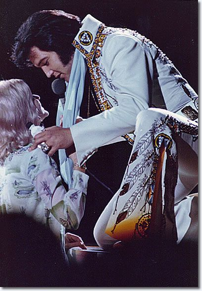 Elvis Presley Huntsville, AL - May 31, 1975. Sometimes during concerts girls would come to the stage and Elvis would stop singing and  kneel and kiss them.
