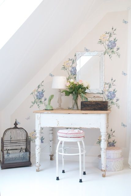 sweet little table and pretty floral wallpaper