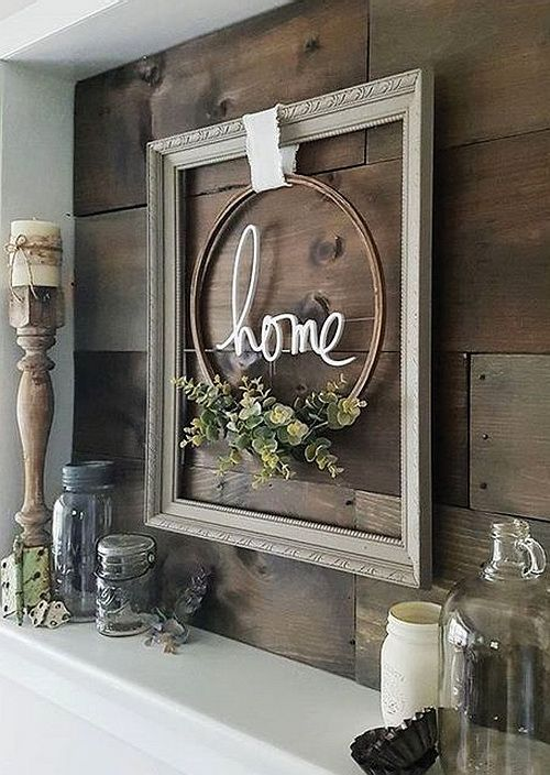 adorable farmhouse gray frame with embroidery hoop wreath, natural greenery with word home scrolled inside