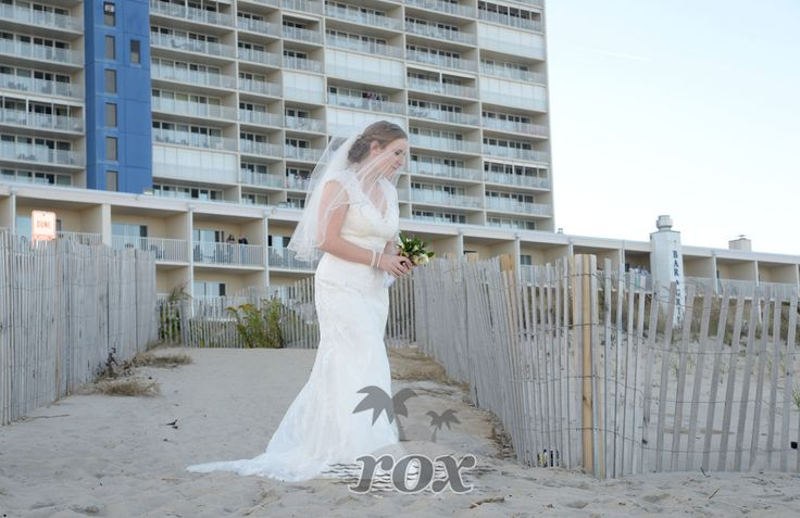 Beach wedding bride at the Carousel Hotel in Ocean City, MD:  https://www.roxbeachweddings.com/