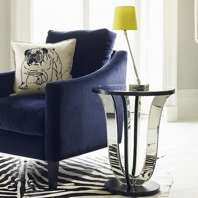funky mirrored side table. rug is fun too