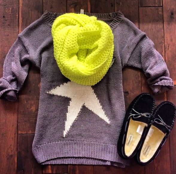 Star sweater, yellow scarf, and moccasins