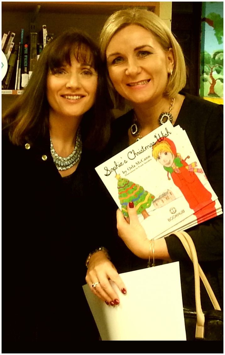 Susan Jane McKenna from Book Hub Publishing and Clodagh McCann at the launch of Orla McCann's book, Sophie's Christmas Wish in Longford, Ireland. November 2015.