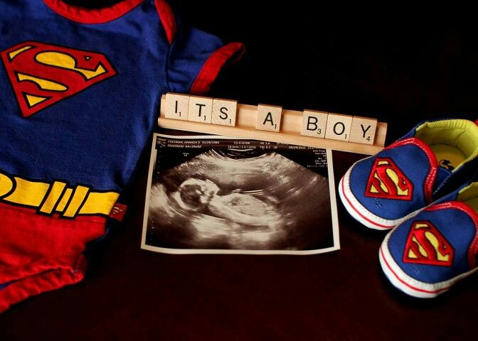 It's a boy gender reveal using superman and scrabble.