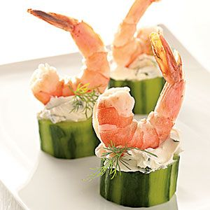 Shrimp in Cucumber Cups  Yield: Makes 30 appetizer servings  1 (8-oz.) package cream cheese, softened $  1/4 cup sour cream  1 tablespoon fresh dill  1 tablespoon chopped fresh chives  1 tablespoon fresh lemon juice  1/4 teaspoon salt  2 English cucumbers  30 Perfect Poached Shrimp, peeled  Garnish: fresh dill sprigs