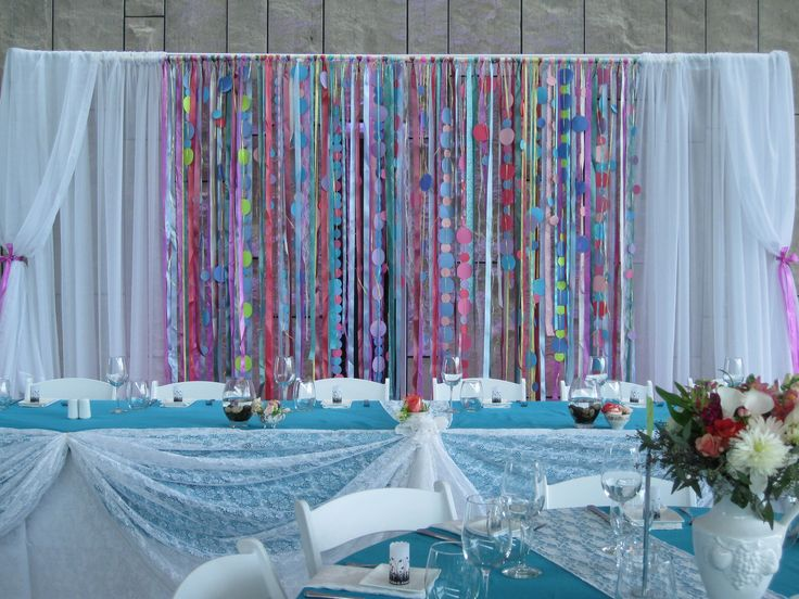The ribbon backdrop we created for this wedding.