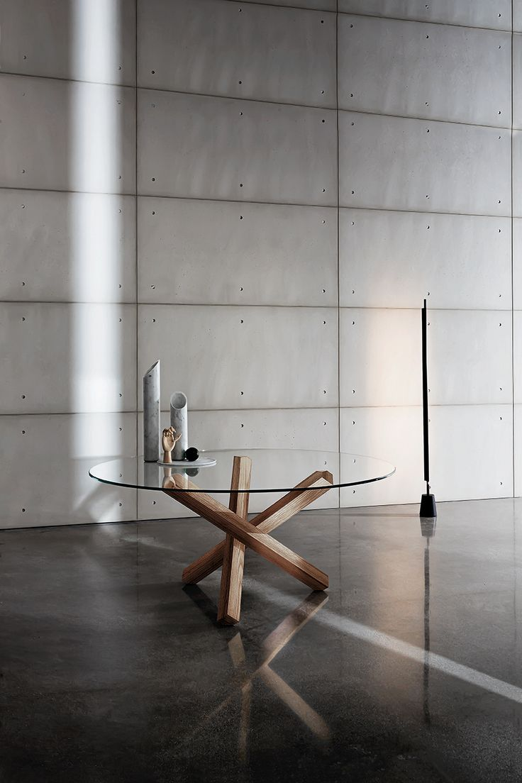 The warm of wooden base and the lightness of glass in Aikido #table. #furniture #design #interior #home #Sovetitalia