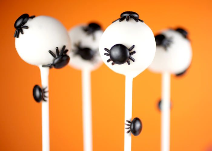 little spiders crawling all over the cake pops - not a cake pop person,  but this would be a great decorating idea for bon bons!