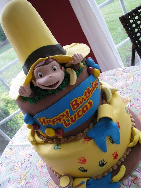Cakes inspired by Books.  Awesome Curious George Book Cake.  Lots of Fondant icing I can tell.