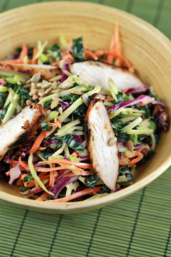 Fresh broccoli slaw and kale salad with chicken tossed in a sweet and spicy dressing. This vegetable and protein packed salad is a light and delicous meal!