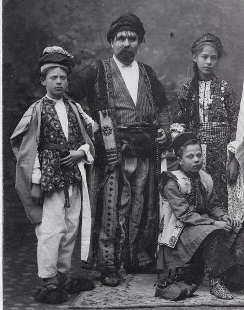 Kurds from the Zagros Mountains, in traditional dresses. Northern Iraq, ca. early 20th century.