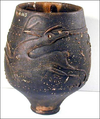 Roman beakers like this were made around the Nene Valley in 200-300 AD. Decoration, here a dog chasing a deer, was added after the pot had been thrown.