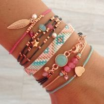 Love the coral and turquoise tones of these beautiful stacked bracelets #Fashion #Jewellerymaking: