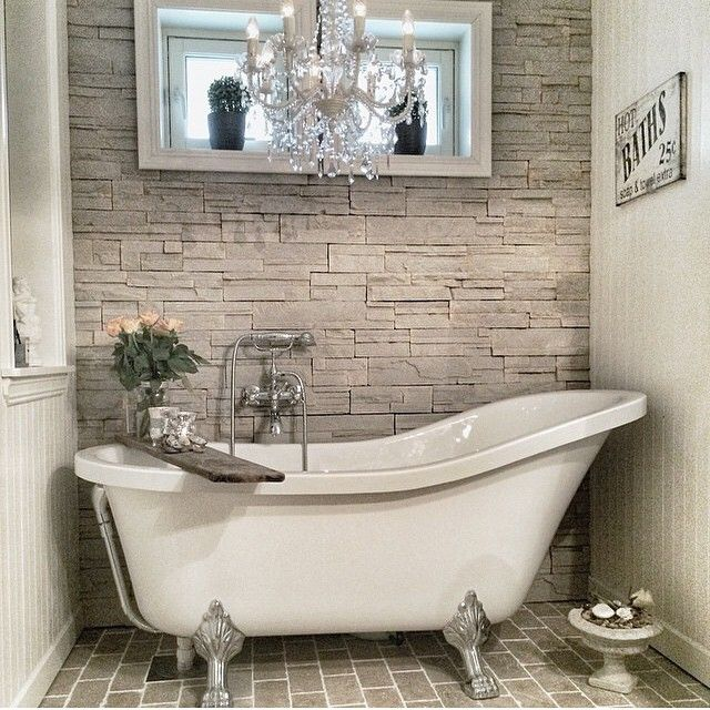 This pretty bath might look squeezed in but still looks inviting and relaxing.  #bathroom #clawbath #stone