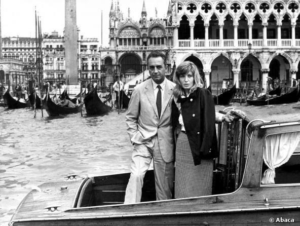 Monica Vitti stands with Michelangelo Antonioni in Venice in 1964.