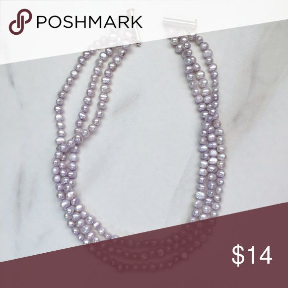 Beautiful three strand real pearl necklace Real three strand pearl necklace with silver closure. The pearls are dyed a soft lavender. This is a timeless piece that you can wear with tees to formal dresses. Jewelry Necklaces