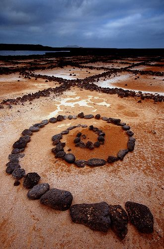 Salinas del Janubio, Lanzarote, Canary Archipelago - This is the biggest salt refinery in the region and has been made a nature conservancy. Originally these saltworks were a natural lagoon that over the years were isolated from the sea by volcanic materials disgorged by the eruptions of the volcanoes of the Timanfaya Park. Here, someone has used one of the disused salt pans to construct a piece of land art out of volcanic rocks.