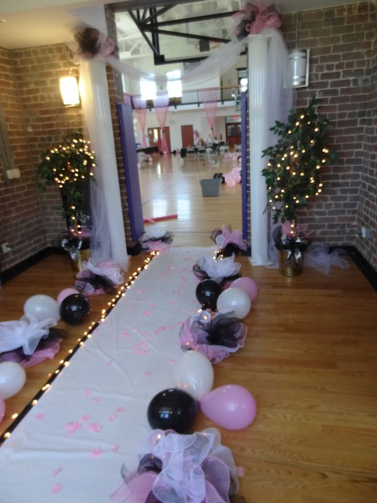 Cheap pathway. I made deco mesh puffs, groups 3 balloons together between them, and taped down a plastic pathway with non-stick tape. Use Christmas lights for an added effect.