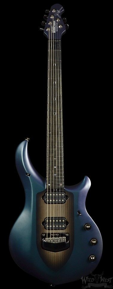 Ice blue 6 string electric guitar promoted by John Petrucci, famous guitarist for DREAM THEATER: Ernie Ball Music Man Majesty Arctic Dream in Ebony. RESERCH by DdO:) - Basswood with maple top and mahogany through neck. Bridge: Custom John Petrucci Music Man® Piezo floating tremolo, made of black pearl plated, hardened steel with stainless steel saddles. Almost 7 pounds wt. 3-way toggle pickup selector.