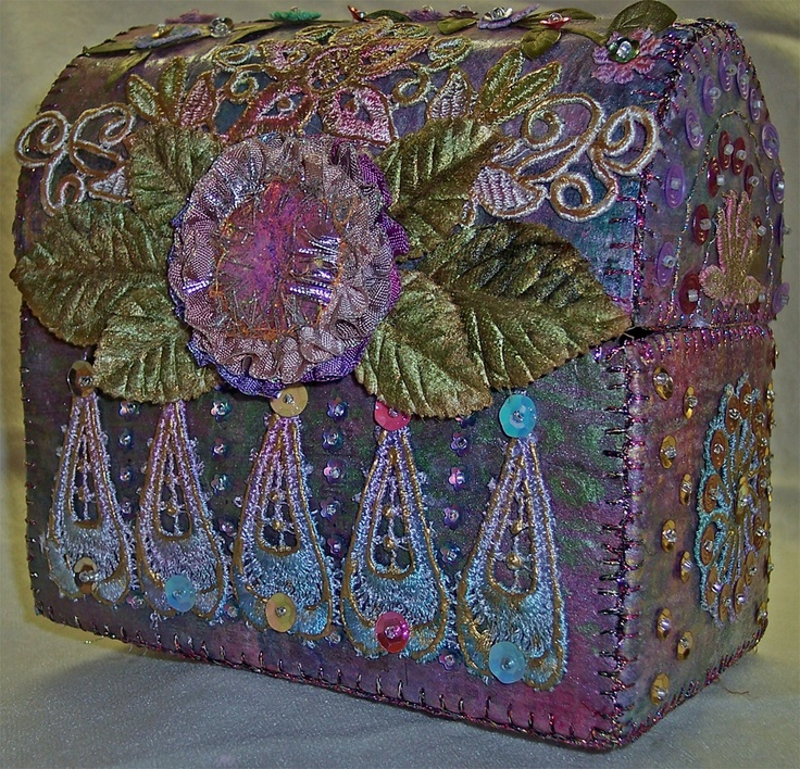 Casket made with newspaper, lace, beads, ribbons and things from my work table