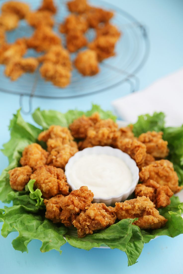 Super easy, crispy buttermilk popcorn chicken bites can be quickly homemade with few ingredients! Serve with hot sauce, honey or Ranch dressing. A scrumptious, fun spin on your typical weeknight meals