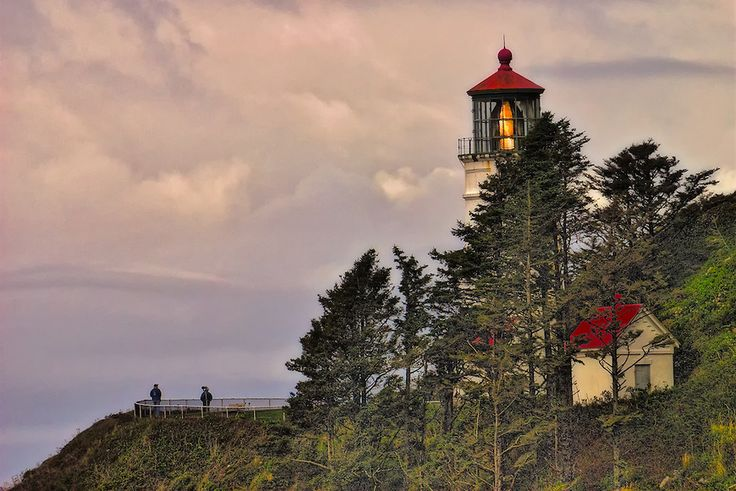 Heceta Head Lighthouse at Dusk in Devils Elbow State Park Oregon, USA...Heceta Head State Park (which includes Devils Elbow State Park) is located in a cove at the mouth of Cape Creek. There are picnic tables sheltered from the wind and a great view of the ocean. A short trail leads to the historic Heceta Head lighthouse and lighthouse keeper's house. A recently-completed trail gives you a spectacular view of the coast north to Cape Perpetua...Heceta Head trail is part of a 7-mile network…