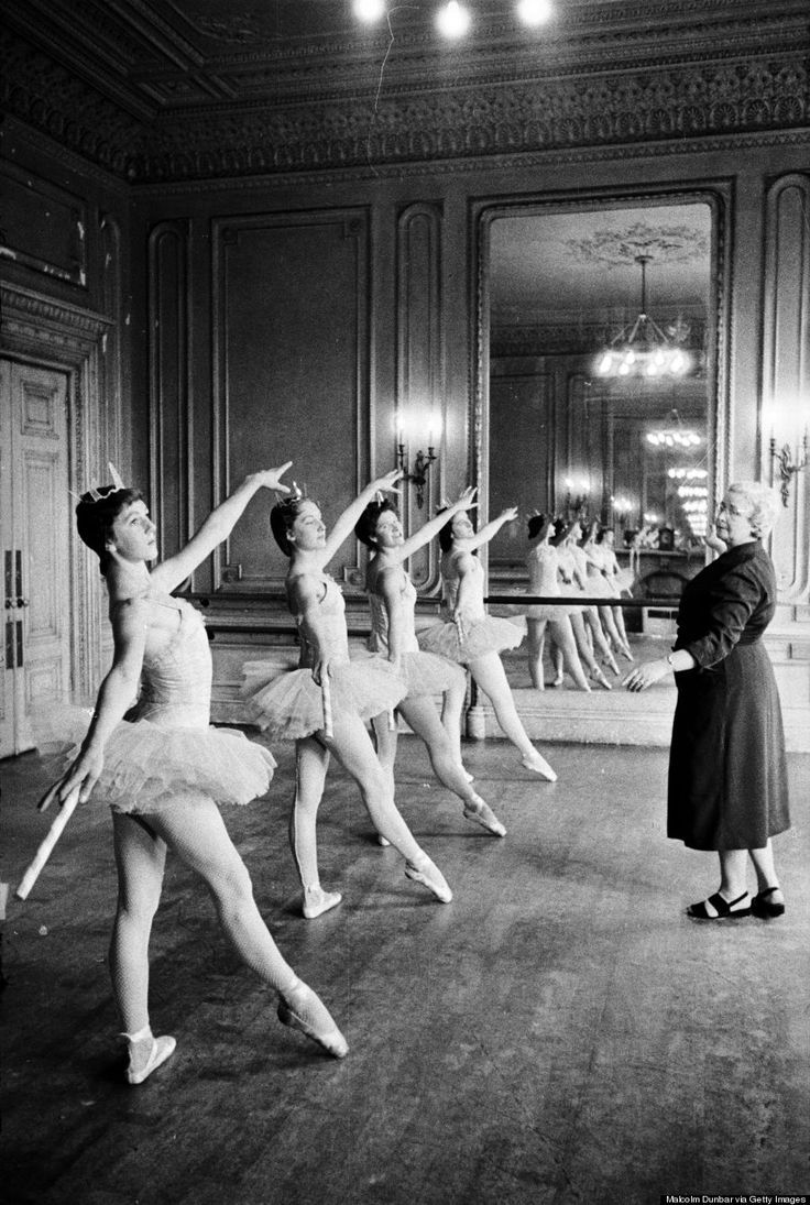 Ballet teacher Marjorie Middleton instructing her pupils in ballet positions during a lesson in one of the studios at the Scottish Ballet School at Grosvenor Crescent, Edinburgh in 1955.