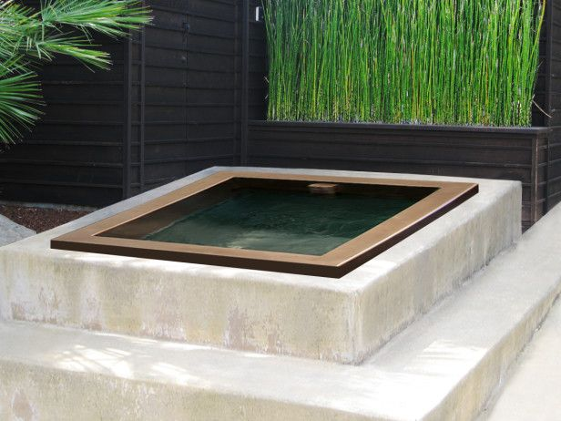 Like a jewel set in a ring, this diminutive but striking plunge pool from Diamond Spas provides a distinct contrast to the surrounding white and green color palette.