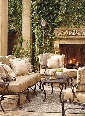An ivy covered fireplace just like this would be at the end of my pergola. I even really like the furnishings and colors from front gate.