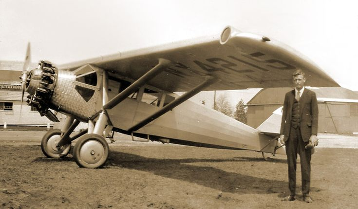"""Charles A. Lindbergh and the Ryan B-1X Brougham (NX4215) presented to him in 1928 by the manufacturer Mahoney Aircraft Corporation (formerly Ryan Airlines) after the """"Spirit of St. Louis"""" had been retired."""