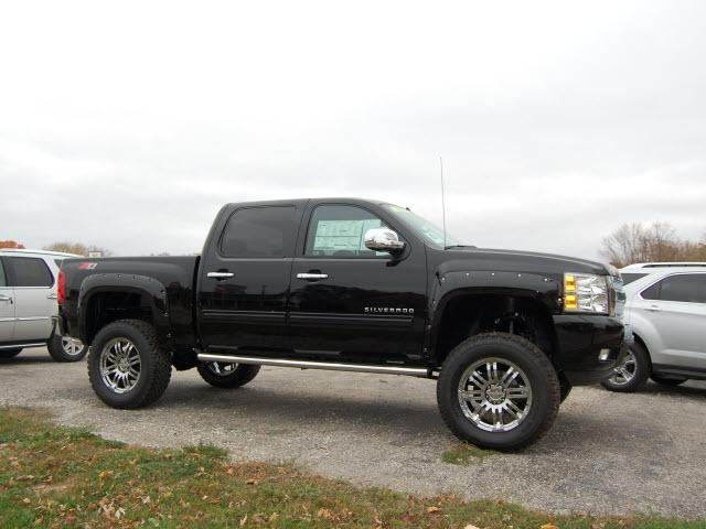 Black 4 door lifted silverado. * What a dream. I'd buy different rims though..