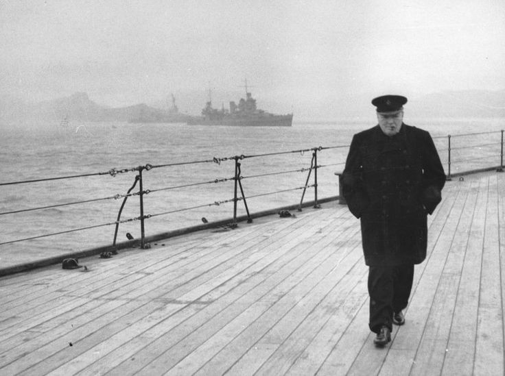 Winston Churchill walking the deck of the battleship HMS Prince of Wales during the Atlantic Conference.