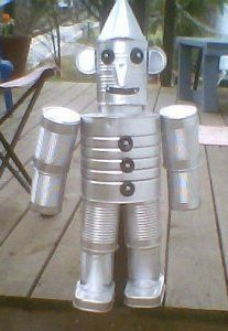 Here's a cute Tin Man made from recycled food cans. First spray paint all cans and paint nose and mouth and pop tops black.