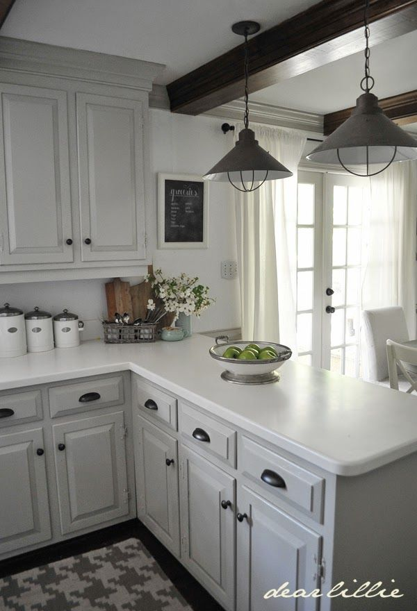 Cabinet and Trim Color: London Fog in Semi-Gloss Wall Color: was here but very similar to Simply White in Matte