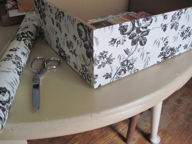 my first attempt at covering a shoe box with contact paper, this is how I plan to make all my storage for my office remodel. I want to put all my shoes in clear plastic containers so they are easier to see, so why not re-use the boxes instead of just throwing them away? Box ($0) Contact paper ($1 at the Dollar Store) One roll of paper covers 4 to 5 shoe boxes, depending on how big they are.
