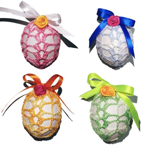 Set of 4 Hand Crocheted Crochet Easter Egg Covers. Hand crocheted with an ombrè cotton thread with satin ribbon and a flower decoration. Used for putting hard boiled eggs or polystyrene eggs inside of it. It is a great gift idea.  Package includes: 4 Crocheted Easter Egg Covers 1 Storage Bag