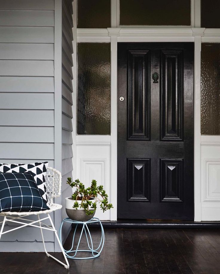 Black Doors Almost Ground The Home They Act As A Focal Point Drawing Your