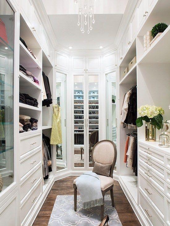 Narrow walk in closet with plenty of storage space