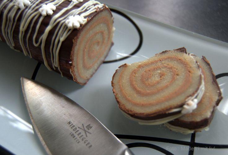 Den lækreste opskrift på et helt klassisk stykke konfekt, nemlig marcipanroulade med nougat, som overtrækkes med lækker chokolade og pyntes fint
