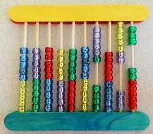 Zelf een abacus maken: use 10 bamboo skewer with 10 beads in each so you get a 10 x 10 abacus.  Here's an image of a home-made abacus one of my customers made using bamboo skewers, craft sticks, and beads: