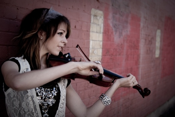 Lindsey Stirling is an American violinist, dancer, performance artist, and composer. She presents choreographed violin performances, both live and in music videos found on her YouTube channel, Lindseystomp, which she introduced in 2007. In 2010, Stirling was a quarter-finalist on the fifth season of America's Got Talent, where she was known as the Hip Hop Violinist