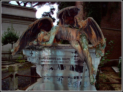 The figure of the angel is so beautifully depicted draped over a tomb in sorrow.  Cimitero monumentale del Verano, Roma
