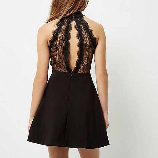 Woven stretch fabric Fitted waist High neckline  Sleeveless with lace trim Flared skirt