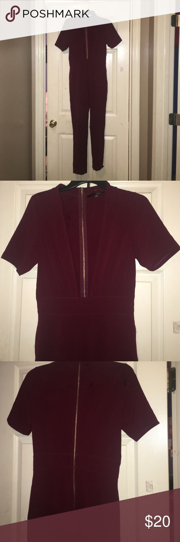 Plunging neck jumpsui Burgundy jumpsuit with plunging neck . Size m but runs small. Never worn , only tried on . Tags has been cut out Pants Jumpsuits & Rompers