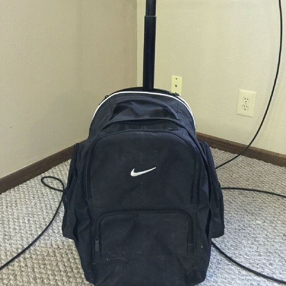 Nike rolling backpack Nike backpack with extendable handle and rolling wheels. Worked great for heavy nursing books for me! Still in great condition and ready for more books! Nike Bags Backpacks