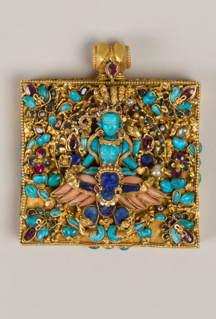 Gold Amulet case. Hindu God Vishnu (carved turquoise) flying on winged (coral) Garuda (lapis lazuli) 17th–19th C. Nepal. rubies, sapphires, emeralds, pearls, zircon 2 1/2 x 2 1/4""